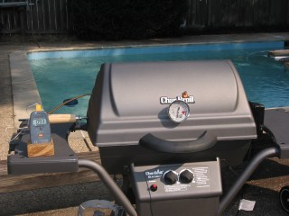 Outside view, RK Drum roaster in gas grill